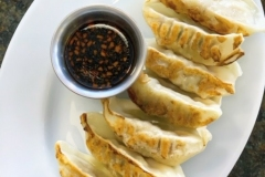 GYOZA - Try our crowd's favorite appetizer! 7 pcs. Chicken or Pork steamed fried dumplings with our special house sauce dipping.