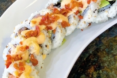 LUCKY 7 - Ichiban premium rolls. Smoked salmon, avocado & cream cheese with sweet and spicy sauce and bacon crumbles!