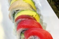 RAINBOW ROLL - Ichiban premium rolls. Crab, cucumber, avocado wrapped with tuna, salmon, izumi-dai, white tuna & avocado