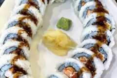 HEY DUDE - Ichiban Premium Rolls. Fried salmon, crab, cucumber with our house special sweet spicy sauce on top.
